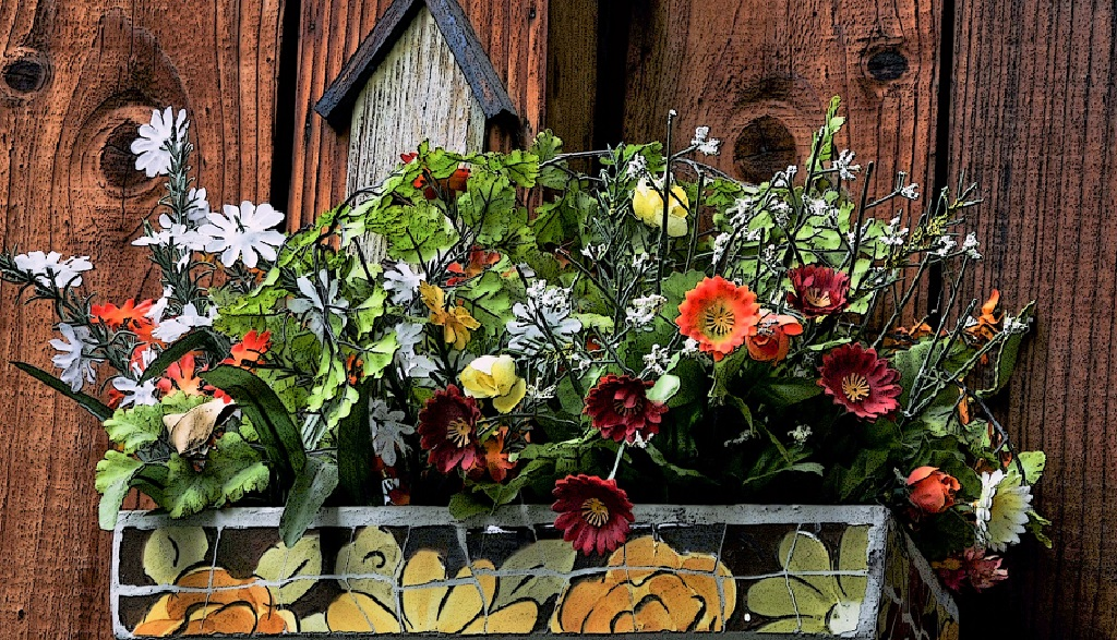 planter box with large flowers painted on it