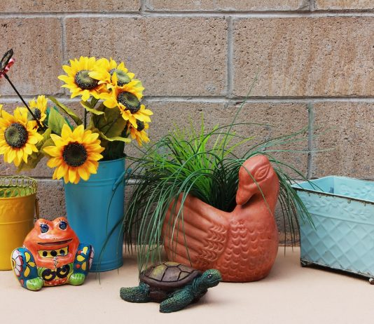 colorful self watering planters with flowers